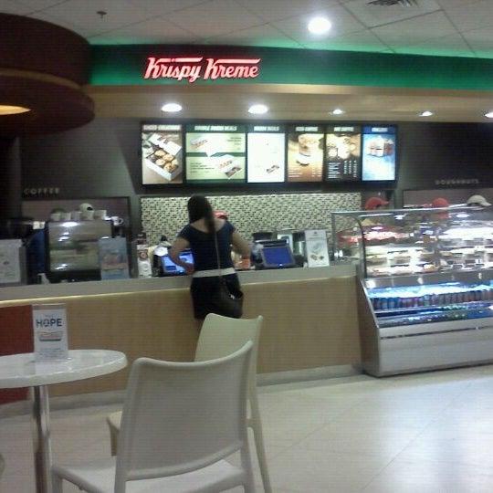 Photo taken at Krispy Kreme by Jon T. on 4/14/2012