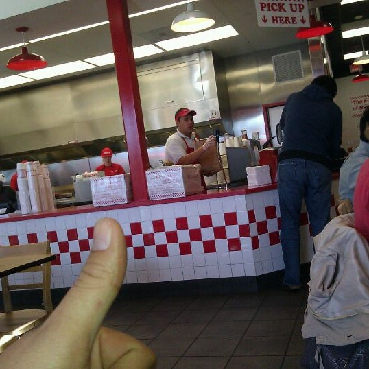 Photo taken at Five Guys by Kirk D. on 12/16/2011