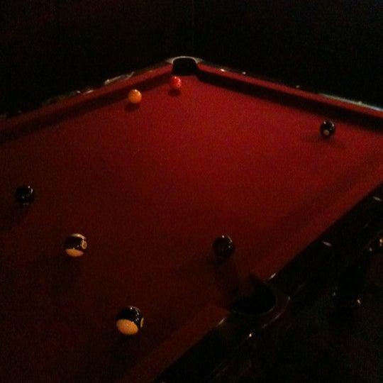 There is another bar upstairs with a billiard table.
