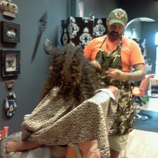 Photo taken at Hail The Hair King Salon & Spa by Vikki B. on 8/18/2011