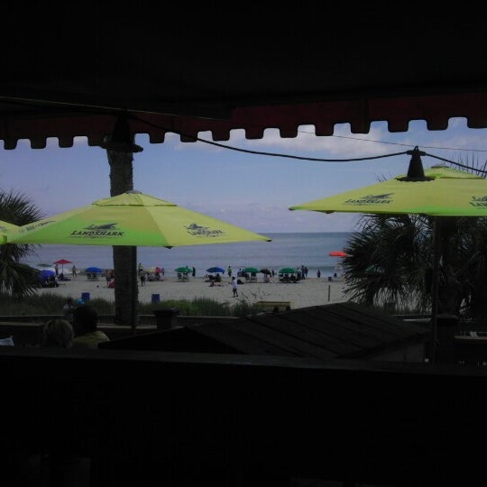 Photo taken at Landshark Bar & Grill by Greg H. on 8/25/2012