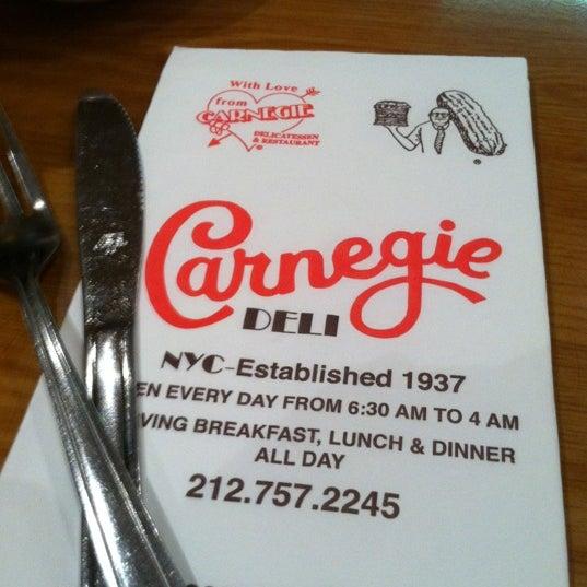 Photo taken at Carnegie Deli by Tara P. on 4/12/2012