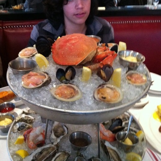Try the plateau de fruits de mer but tell them in France you don't but it in front of you but in the middle of the table.
