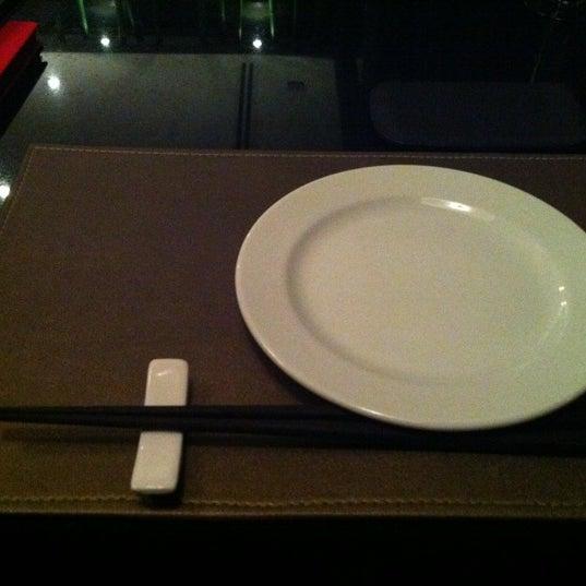 Photo taken at YASASHII Japanese Fusion Cuisine by Ainaveltsac S. on 11/4/2011