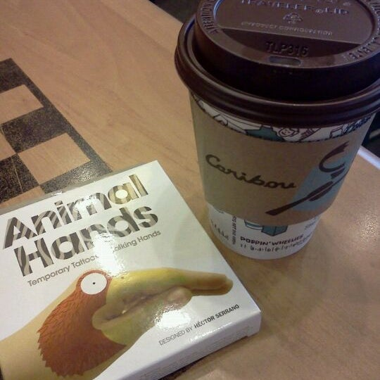 Photo taken at Caribou Coffee by Amy B. on 3/26/2012