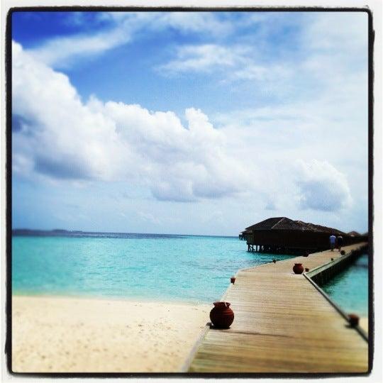 Photo taken at Vilamendhoo Island Resort & Spa by Tolkyn N. on 7/9/2012