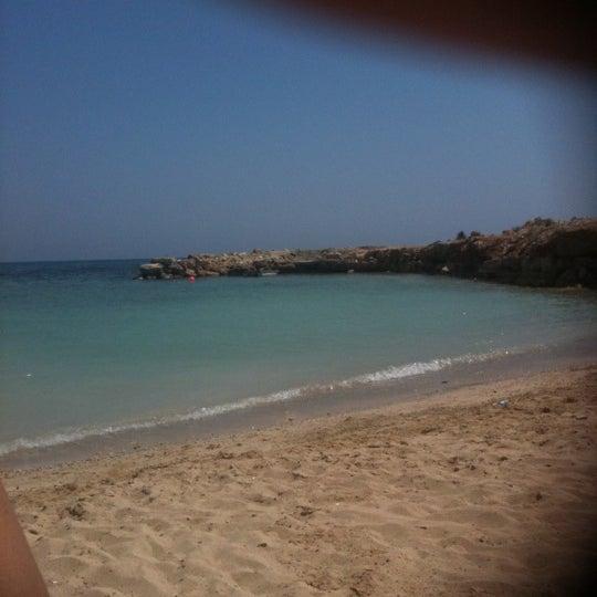 Photo taken at Makronissos Beach by Andri K. on 7/10/2011