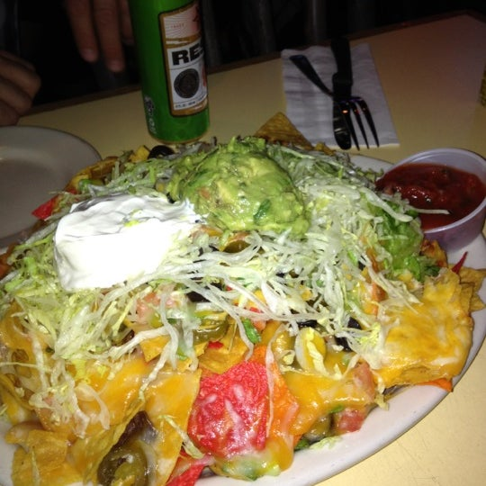 Photo taken at Sunset Cantina by Jackie T. on 5/1/2012