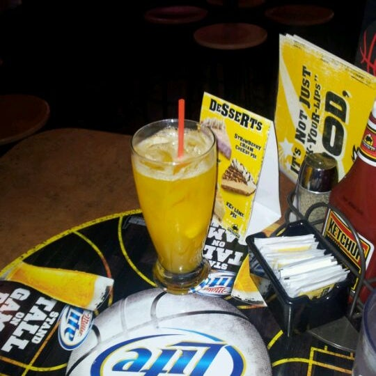 Photo taken at Buffalo Wild Wings by Jennifer A. on 2/21/2012