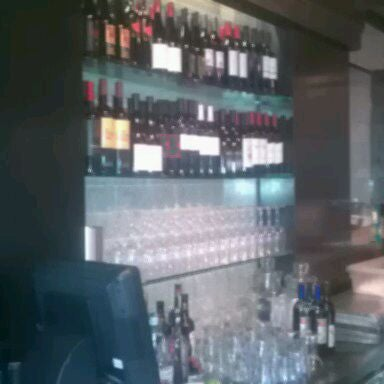 Photo taken at Timo Wine Bar by Shawn F. on 10/4/2011