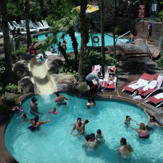 Photo taken at Flamingo GO Pool by Boy R. on 7/29/2012