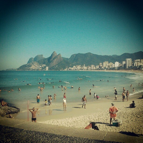 Photo taken at Ipanema Beach by Marcelo M. on 8/12/2012