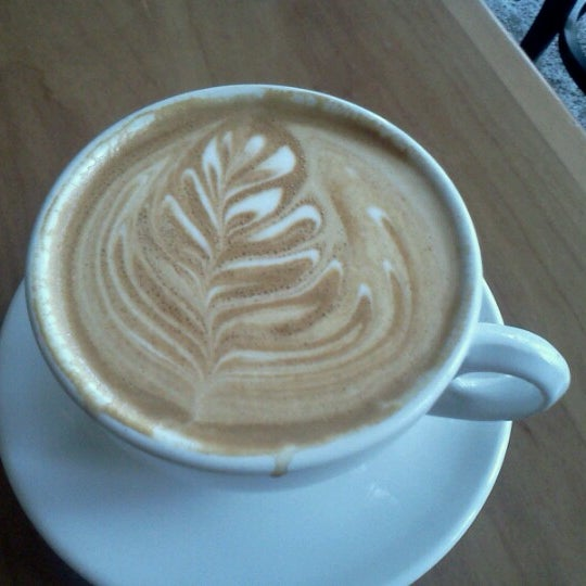 Photo taken at Victrola Cafe and Roastery by Justin W. on 6/26/2012