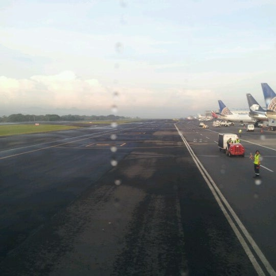 Photo taken at Gate 5 Aeropuerto Internacional Juan Santamaria by Steven L. on 8/8/2012