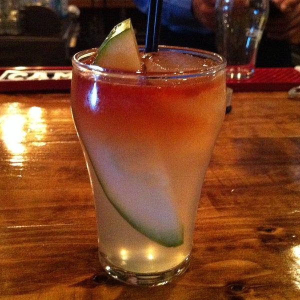 Photo taken at Pint + Jigger by Melissa C. on 7/30/2012
