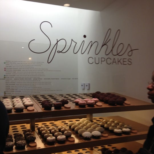 Photo taken at Sprinkles Cupcakes by Caitlin K. on 2/29/2012