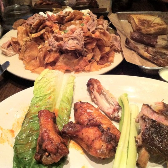 Photo taken at Doc Crow's Southern Smokehouse & Raw Bar by Sarah V. on 7/1/2012