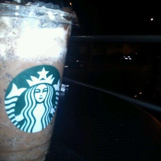 Photo taken at Starbucks by Okta M. on 12/30/2011