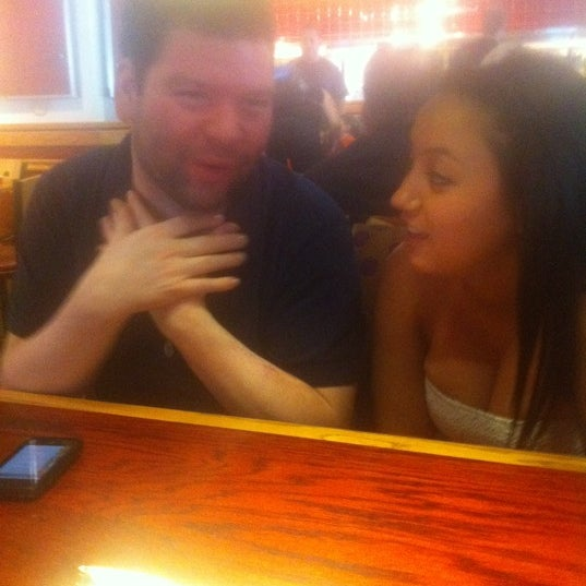 Photo taken at Red Robin Gourmet Burgers by Emily D. on 7/3/2011