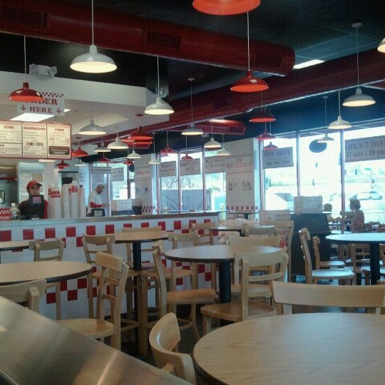 Photo taken at Five Guys by Tom S. on 3/22/2011