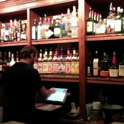 Photo taken at Joe Squared Pizza & Bar by Greg M. on 10/12/2011