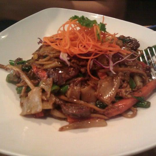 Photo taken at Nahm Thai Kitchen by Mina V. on 11/12/2011