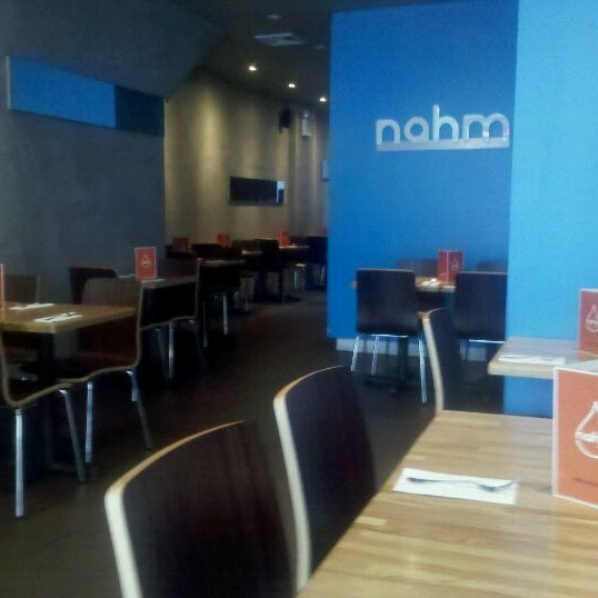 Photo taken at Nahm Thai Kitchen by Gary S. on 9/22/2011