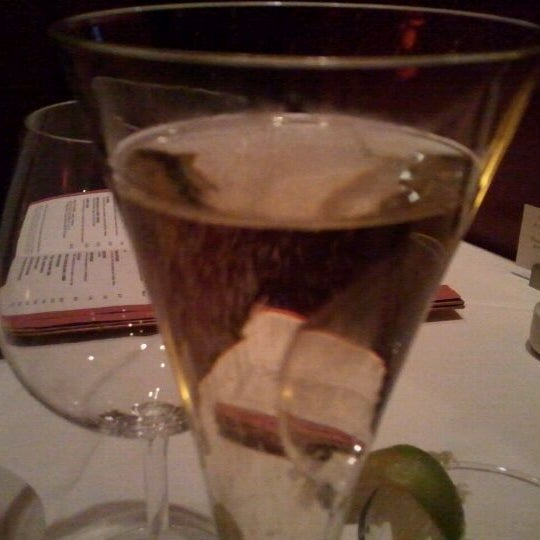 Photo taken at Fleming's Prime Steakhouse & Wine Bar by Roberta F. on 12/25/2011