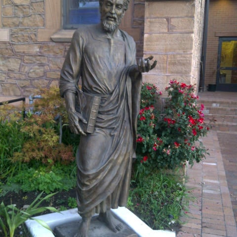 A statue of St Mark is in the outer courtyard and the inner courtyard has another statue.