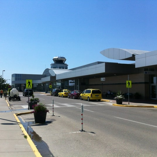 Photo taken at Saskatoon John G. Diefenbaker International Airport (YXE) by Jon M. on 7/9/2012