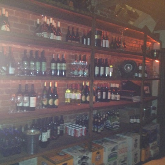 Photo taken at Custom Wine Bar by Hannah B. on 3/3/2012