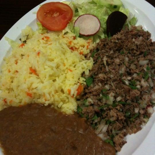 Photo taken at El Salvadoreño by Jenny V. on 4/22/2012