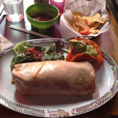 Photo taken at Burrito Bar & Kitchen by Tom D. on 8/7/2012