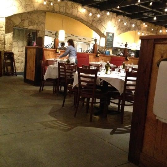 Photo taken at Romano's Macaroni Grill by Sergio L. on 3/25/2012