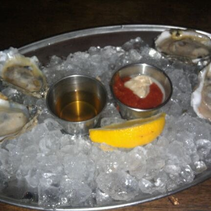 Photo taken at Doc Crow's Southern Smokehouse & Raw Bar by Rich on 8/24/2011
