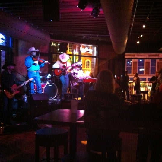 Photo taken at Honky Tonk Central by Courtney F. on 3/31/2012