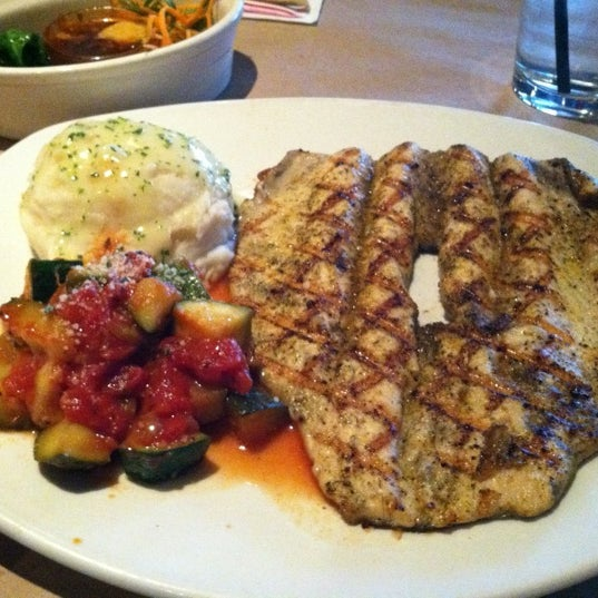 Photo taken at Bonefish Grill by Buck H. on 4/24/2012