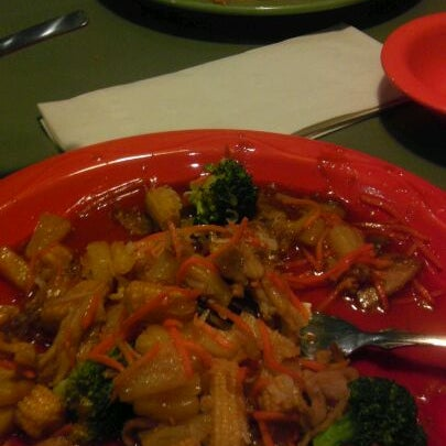 Photo taken at HuHot Mongolian Grill by Nicole R. on 1/2/2012