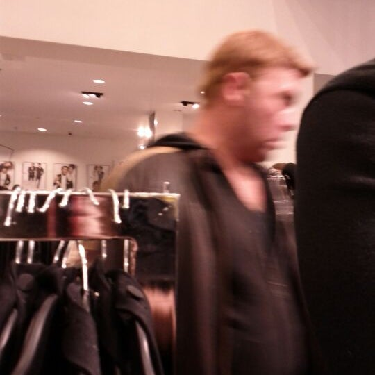 Photo taken at H&M by Gina S. on 12/31/2011