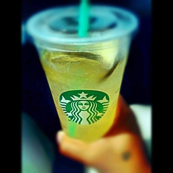 Photo taken at Starbucks by carlos v. on 7/27/2012