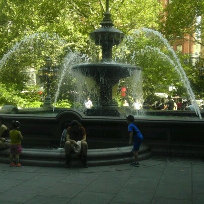 Photo taken at City Hall Park by Tristan P. on 8/4/2012