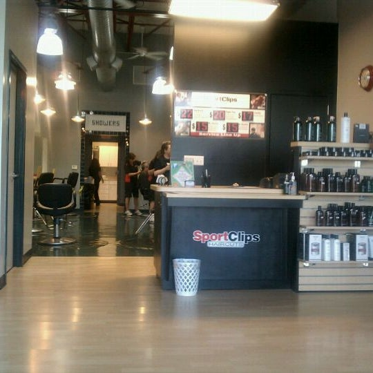 Photo taken at Sport Clips Haircuts of Mooresville by Marcus C. on 6/30/2011
