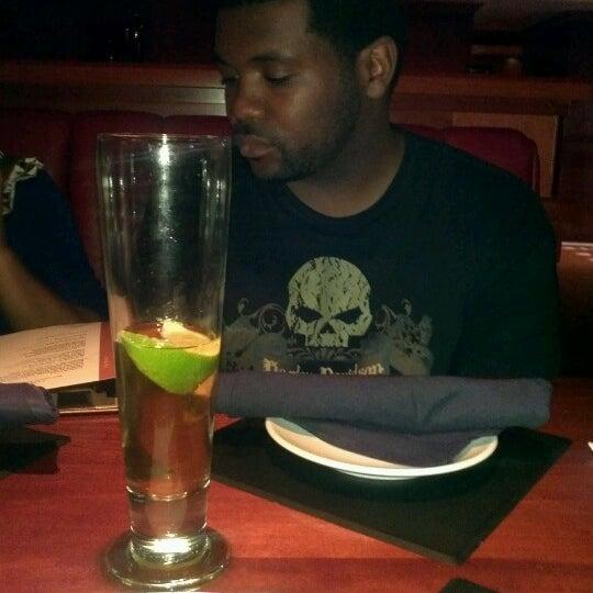 Photo taken at Fleming's Prime Steakhouse & Wine Bar by Sam J. on 7/6/2012