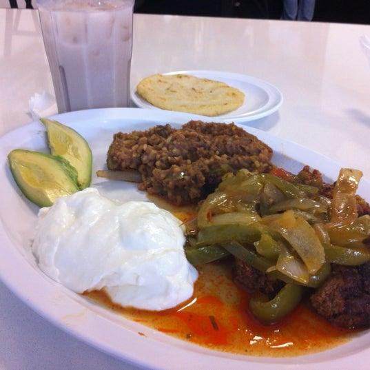 Photo taken at El Salvadoreño by Michael E. on 7/21/2012