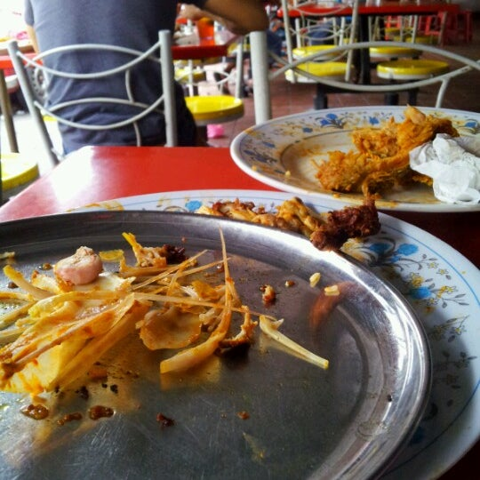 Photo taken at Bangsar Fish Head Corner by Alia A. on 7/7/2012