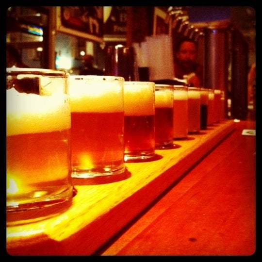 Photo taken at Portsmouth Brewery by Kat D. on 8/16/2011