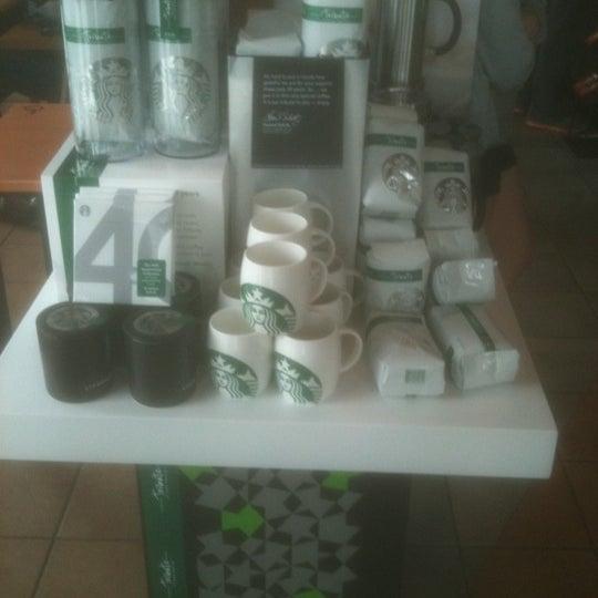 Photo taken at Starbucks by Justin B. on 3/8/2011
