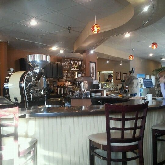 Photo taken at Arcedium Coffeehouse Inc by Andrea S. on 1/24/2012