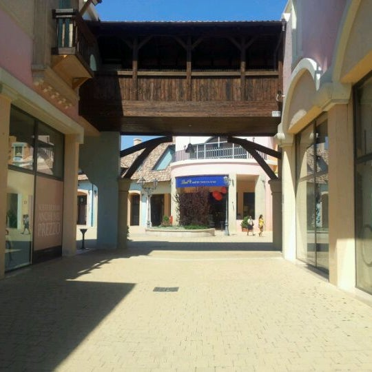 Photo taken at Fashion District - Molfetta Outlet by Stefano on 8/17/2011