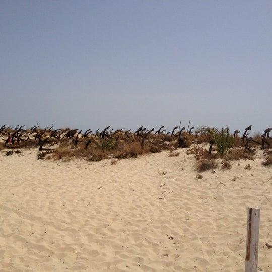 Photo taken at Praia do Barril by Nuno A. on 8/19/2012
